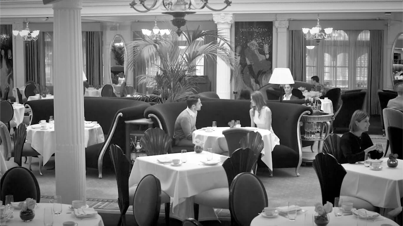 Christopher Guy photo in black and white of people dining at the Georgian restaurant, Harrods.
